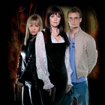 "Emilie Ullerup as Ashley Magnus, Amanda Tapping as Helen Magnus, Robin Dunne as Will Zimmerman of ""Sanctuary"""