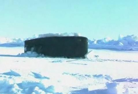 U.S.S. Alexandria crashes through the Arctic ice