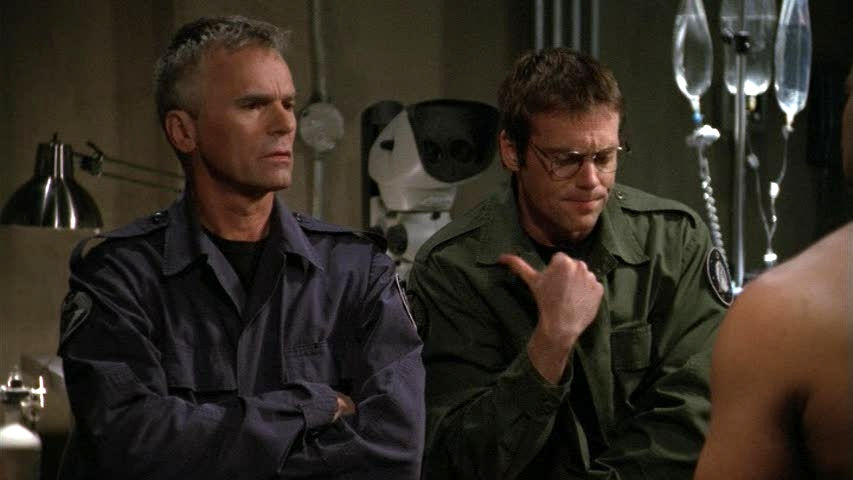 Jack O'Neill and Daniel Jackson talk to Teal'c in 'Orpheus'