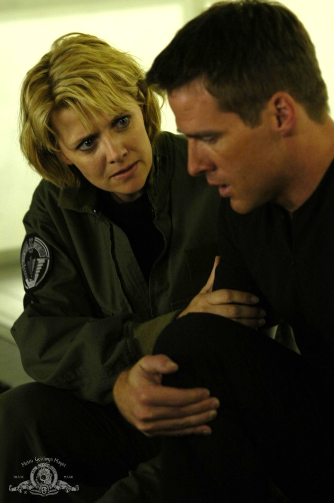 Samantha Carter comforts Cameron Mitchell in 'Collateral Damage'