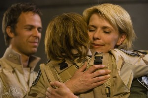 Samantha Carter hugs AU Janet Fraiser as AU Martouf stands nearby in 'Ripple Effect'
