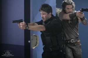 John Sheppard and Ronon Dex storm the room in MILLER'S CROSSING