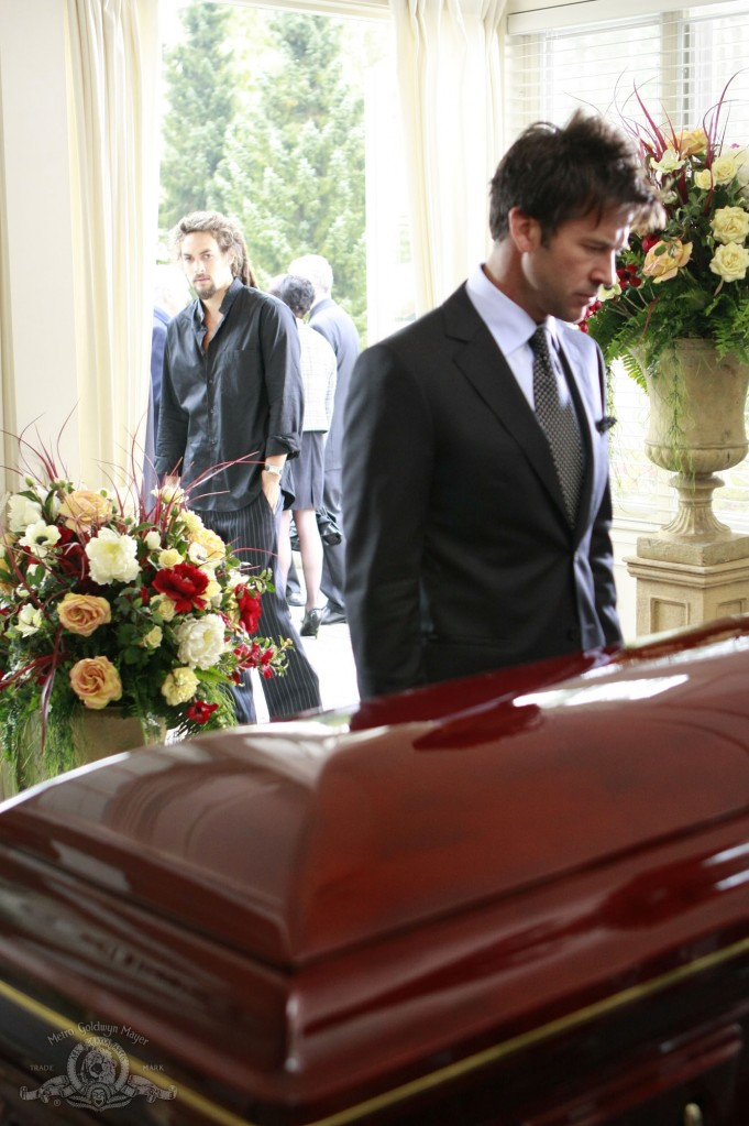 John Sheppard at father's coffin with Ronon Dex looking on in OUTCAST